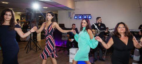 Girls dancing the Kalamatiano at Peter & Emma's Greek Wedding. Odessey Greek Band